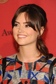 Jenna Coleman sported a youthful vibe with her ponytail and center-parted bangs at the George Foster Peabody Awards.