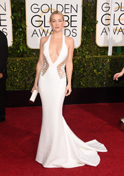 Kate Hudson set the Golden Globes red carpet on fire with this slinky white Atelier Versace gown boasting bejeweled side cutouts and a way-down-to-there neckline.