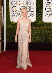 Anna Faris chose a delicate nude Reem Acra gown with a beaded overlay for her Golden Globes look.