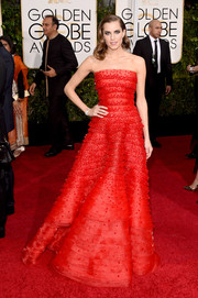 Allison Williams was sweetness overload in a tiered red strapless gown by Armani Prive at the Golden Globes.