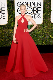 Taylor Schilling made quite an entrance at the Golden Globes in a dramatic crimson halter gown by Ralph Lauren.