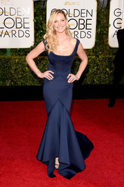 Katherine Heigl cut a shapely figure in a corseted blue mermaid gown by Zac Posen during the Golden Globes.