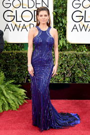 Maria Menounos sheathed her svelte figure in an indigo Gabriela Cadena gown, featuring a racer neckline and abstract-patterned beading, for the Golden Globes.