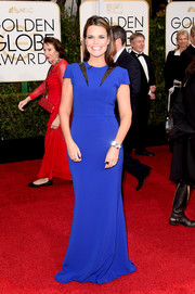 Savannah Guthrie struck a pose on the Golden Globes red carpet wearing an electric-blue gown with cap sleeves and slashed shoulders.
