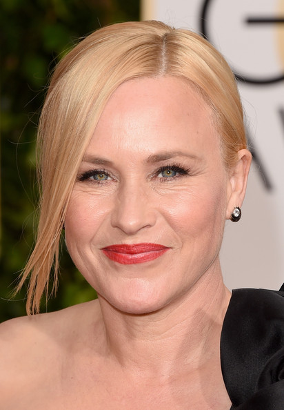 Patricia Arquette wore a sleek bun with bangs hanging down during the Golden Globes.