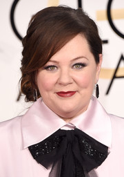 Melissa McCarthy got all dolled up with a side chignon for the Golden Globes.