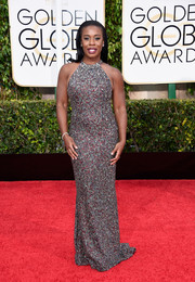 Uzo Aduba sparkled on the Golden Globes red carpet in a heavily embellished Randi Rahm gown in silver with tinges of red.