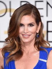 Cindy Crawford looked as fab as ever wearing this feathery hairstyle at the Golden Globes.