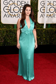 Lana Del Rey chose a vintage Travilla halter gown in a vibrant aqua-green hue for her Golden Globes look.
