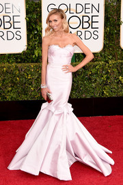 Giuliana Rancic cut a dramatic silhouette in a strapless pale-pink mermaid gown by Maria Lucia Hohan during the Golden Globes.