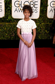 Quvenzhane Wallis kept it youthful and sweet at the Golden Globes in a white and lavender gown with a beaded bodice and a bowed waist.
