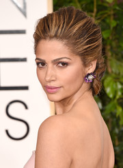 Camila Alves attended the Golden Globes wearing a regal-looking puffed-up chignon.