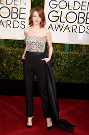 Standing out in a sea of gowns at the Golden Globes, Emma Stone was cooly elegant in a Lanvin jumpsuit with an opulently embellished, strapless bodice and a bowed train.