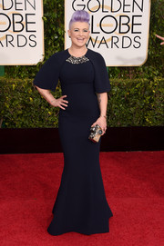 Kelly Osbourne went for muted elegance at the Golden Globes in an inky-blue Edition by Georges Chakra gown featuring bell sleeves and an embellished neckline.