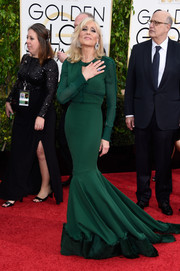 Judith Light chose a long-sleeve emerald mermaid gown for her Golden Globes look.