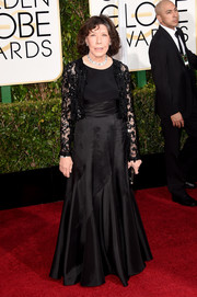 Lily Tomlin attended the Golden Globes wearing a black gown with a matching lace bolero.