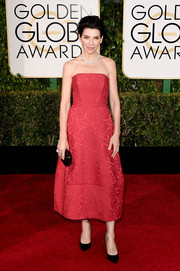 Julianna Margulies went for timeless sweetness at the Golden Globes in a red Ulyana Sergeenko strapless dress with a subtle floral print.