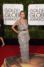 Heidi Klum chose a fun and flirty silver feather dress by Marchesa for her Golden Globes look.