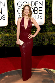 Olivia Wilde was scorching-hot in a plunging red halter dress by Michael Kors at the Golden Globes.