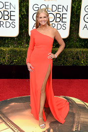 Nancy O'Dell looked alluring at the Golden Globes in an orange one-shoulder gown with a hip-grazing slit.