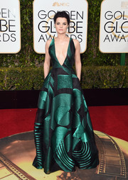 Jaimie Alexander turned heads at the Golden Globes in a geometric-patterned green and black Genny gown with a navel-grazing neckline.