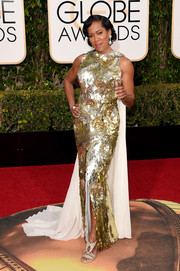 Regina King was a sight to behold at the Golden Globes in a Krikor Jabotian caped gown covered entirely in swirls of paillettes.