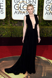Kirsten Dunst showed her more risque side in a black Valentino velvet gown with a cleavage-baring plunge during the Golden Globes.