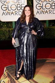 Melissa McCarthy shone on the Golden Globes red carpet in a metallic blue gown from her own line.
