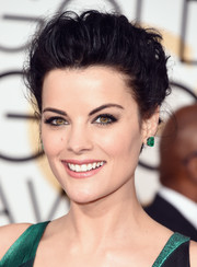 'Blindspot' star Jaimie Alexander complemented her unique green and black gown with smokey eyeshadow.