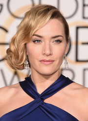 Golden Globe winner Kate Winslet kept her makeup simple and elegant with pale pink lips and a subtle cat-eye.