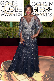 Viola Davis looked regal in a beaded navy gown by Marchesa at the Golden Globes.
