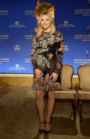 Chloe Grace Moretz added an extra pop of lace with a pair of Christian Louboutin Magicadiva pumps.