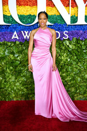 Regina King cut a shapely silhouette in a fitted pink Prada gown with a long train at the 2019 Tony Awards.