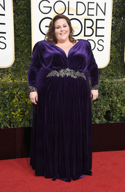 Chrissy Metz worked a purple Christian Siriano velvet gown with a bedazzled waistband and cuffs at the Golden Globes.