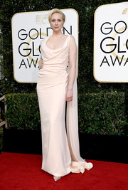 The statuesque Gwendoline Christie looked downright regal wearing this asymmetrical, draped column dress, in palest blush.