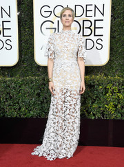 Kristen Wiig worked a see-through white lace gown by Reem Acra at the Golden Globes.