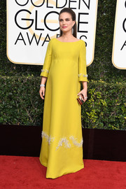 Natalie Portman looked resplendent in an embellished yellow gown by Prada at the Golden Globes.