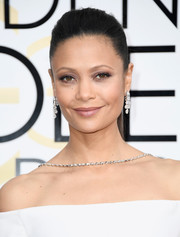 Thandie Newton showed off a stunning pair of Harry Winston diamond chandelier earrings.