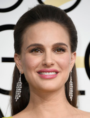 Natalie Portman rounded out her look with a pair of diamond chandelier earrings by Tiffany & Co.