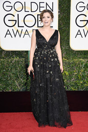 Rachel Bloom looked demure and chic in an embroidered black gown by Christian Siriano at Golden Globes.