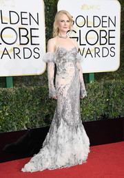 Nicole Kidman went for a frothy white and silver corset gown by Alexander McQueen at the Golden Globes.