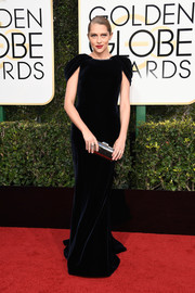 Teresa Palmer was all about understated elegance in a midnight-blue cap-sleeve velvet gown by Armani Privé at the Golden Globes.