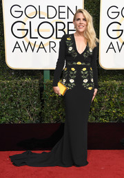 Busy Philipps brightened up her dress with a yellow satin clutch.