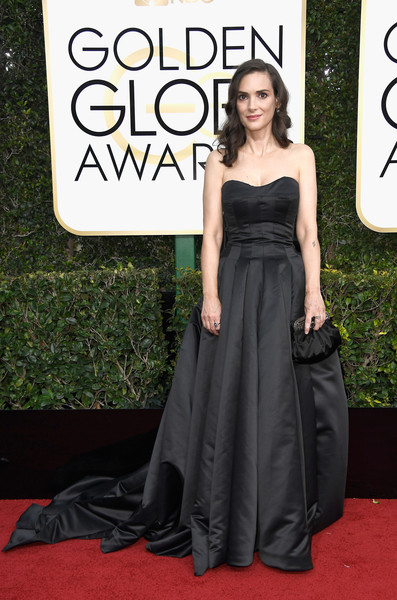Winona Ryder was glamorously goth in a strapless black ball gown by Viktor & Rolf Soir at the Golden Globes.