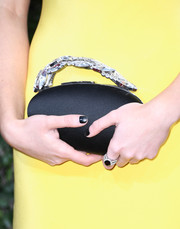 Maisie Williams' gemstone ring was a perfect match to her bejeweled clutch.