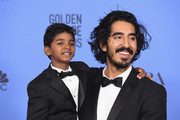 Actors Sunny Pawar (L) and Dev Patel pose in the press room during the 74th Annual Golden Globe Awards at The Beverly Hilton Hotel on January 8, 2017 in Beverly Hills, California.