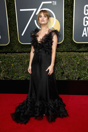 Lily James went the ultra-sweet route in a mega-ruffled black gown by Valentino Couture for her 2018 Golden Globes look.