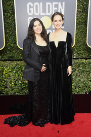 Natalie Portman was a classic beauty in a black Dior Couture velvet gown with a plunging square neckline at the 2018 Golden Globes.