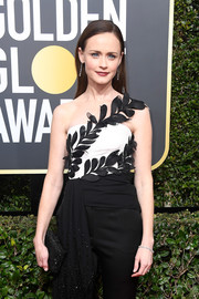 Alexis Bledel attended the 2018 Golden Globes carrying a beaded black clutch by Onna Ehrlich.