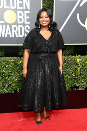 Octavia Spencer complemented her LBD with a pair of elegant Jimmy Choo sandals.